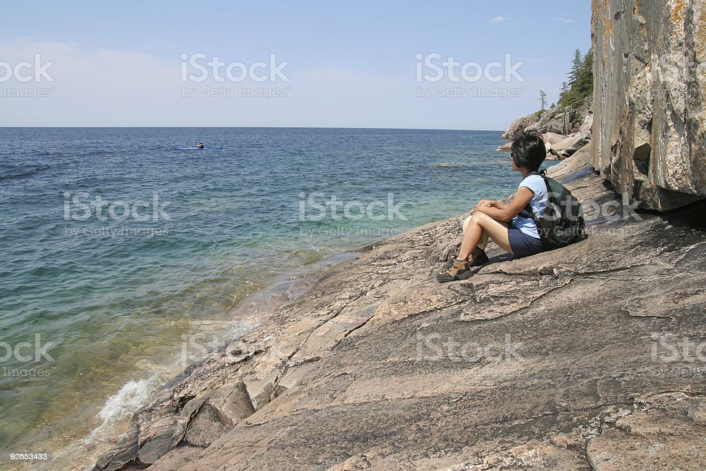 Hiker and Kayaker at Agawa Pictographs royalty-free stock photo