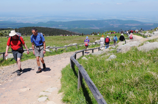 Hiker arriving the peak of Brocken Mountain