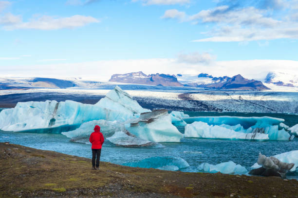 Hiker at Jökulsarlon Glacier Lagoon, Iceland Iceland, Winter, Jokulsarlon, Hiking, Nordic Countries jokulsarlon stock pictures, royalty-free photos & images