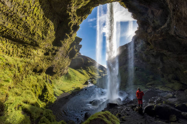 hiker at majestic kvernufoss waterfall in iceland - majestic stock photos and pictures