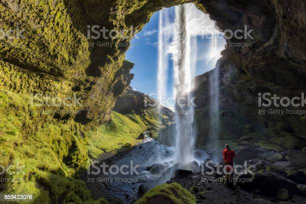 Photo of Hiker at Majestic Kvernufoss Waterfall in Iceland
