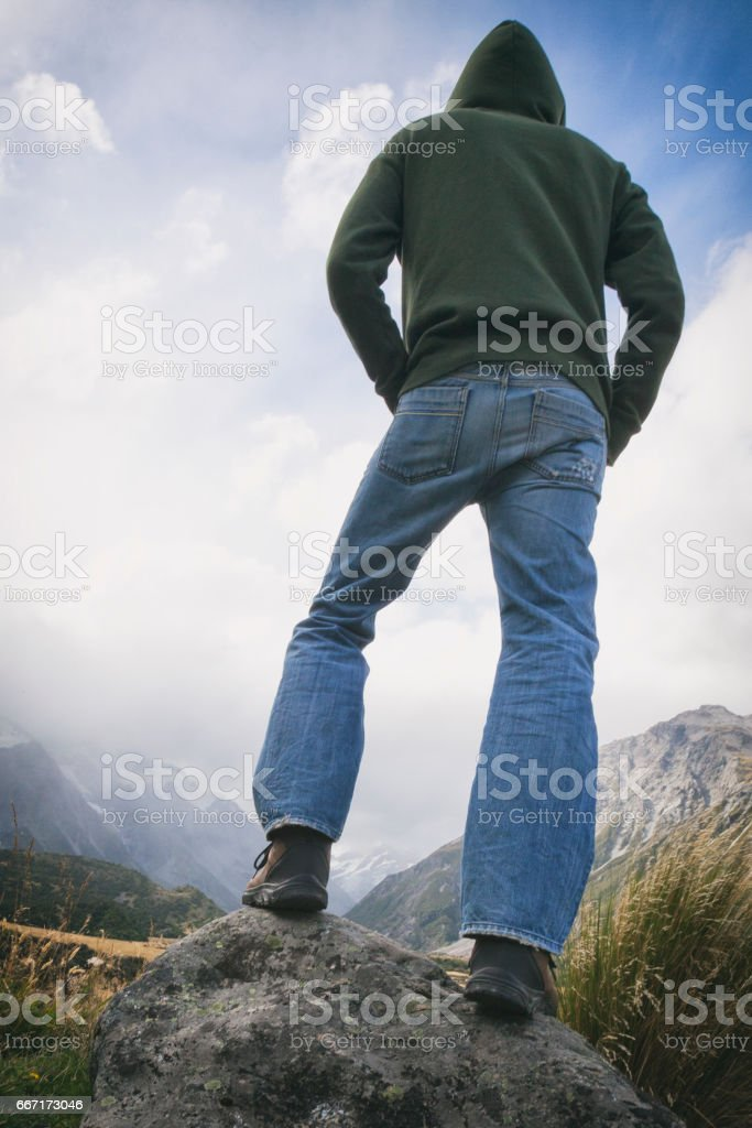 Hiker at Mount Cook of the Southern Alps in New Zealand stock photo