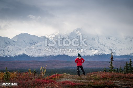 istock Hiker at mountain top with direct view of the Denali Mountain 860331940
