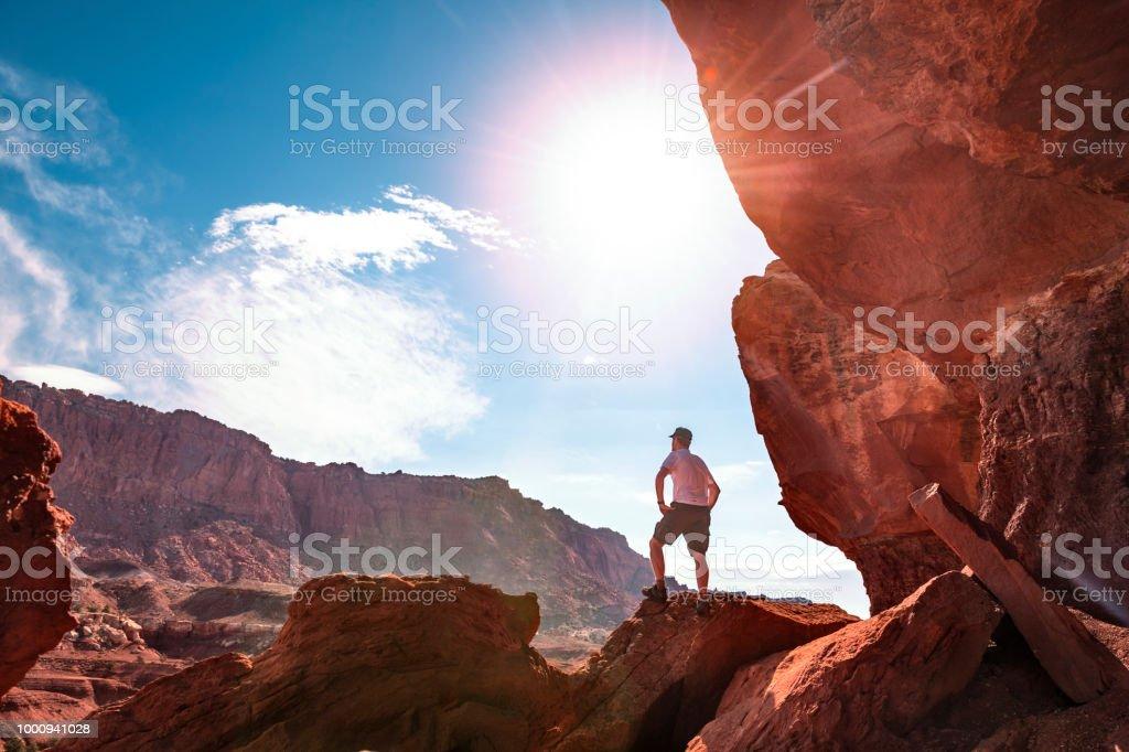 Hiker at rock turret in Utah stock photo