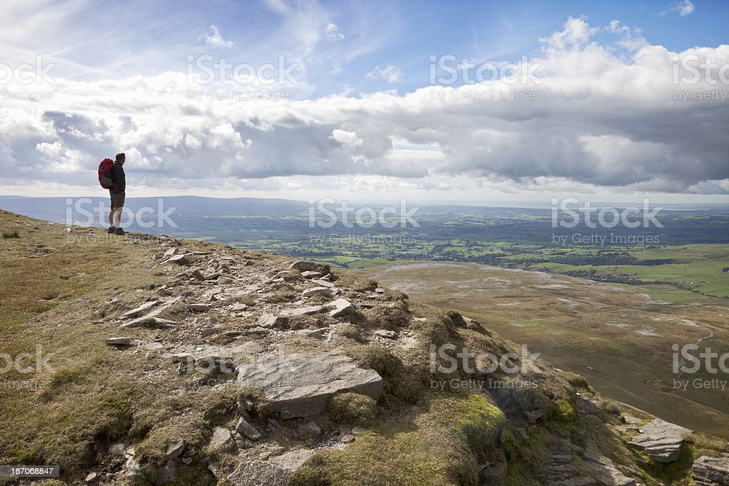 Hiker at the top of Ingleborough stock photo