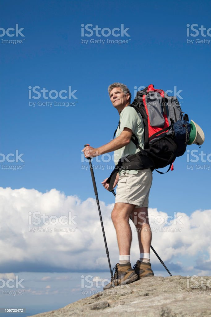 Hiker Backpacker at the top royalty-free stock photo