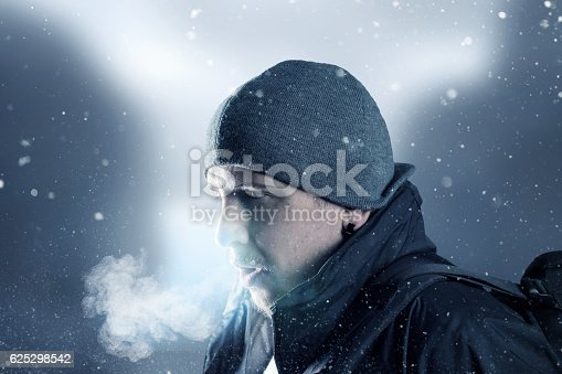 istock hiker breathe out in front of blurred mountain landscape 625298542