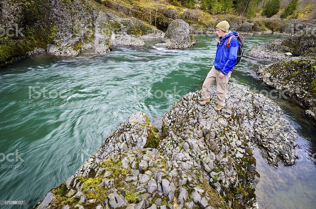Hiker by river stock photo