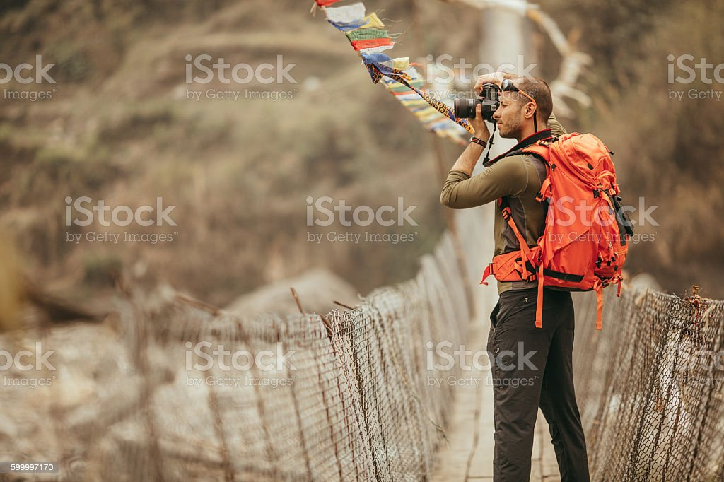 Hiker capturing the view stock photo