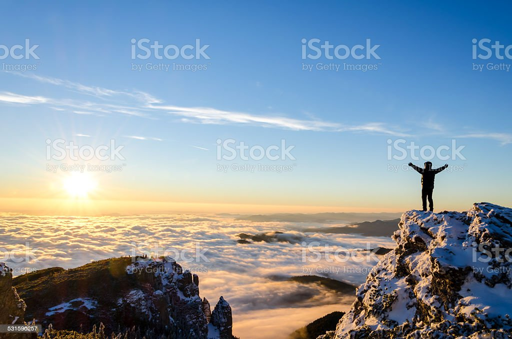 hiker celebrating success stock photo