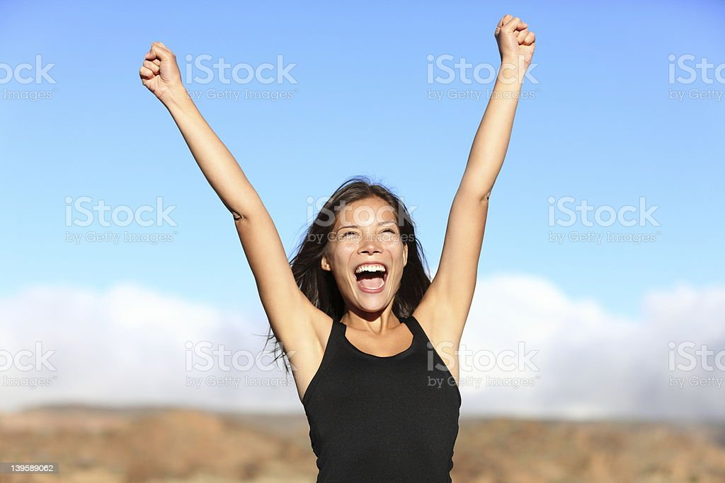 Hiker cheering stock photo