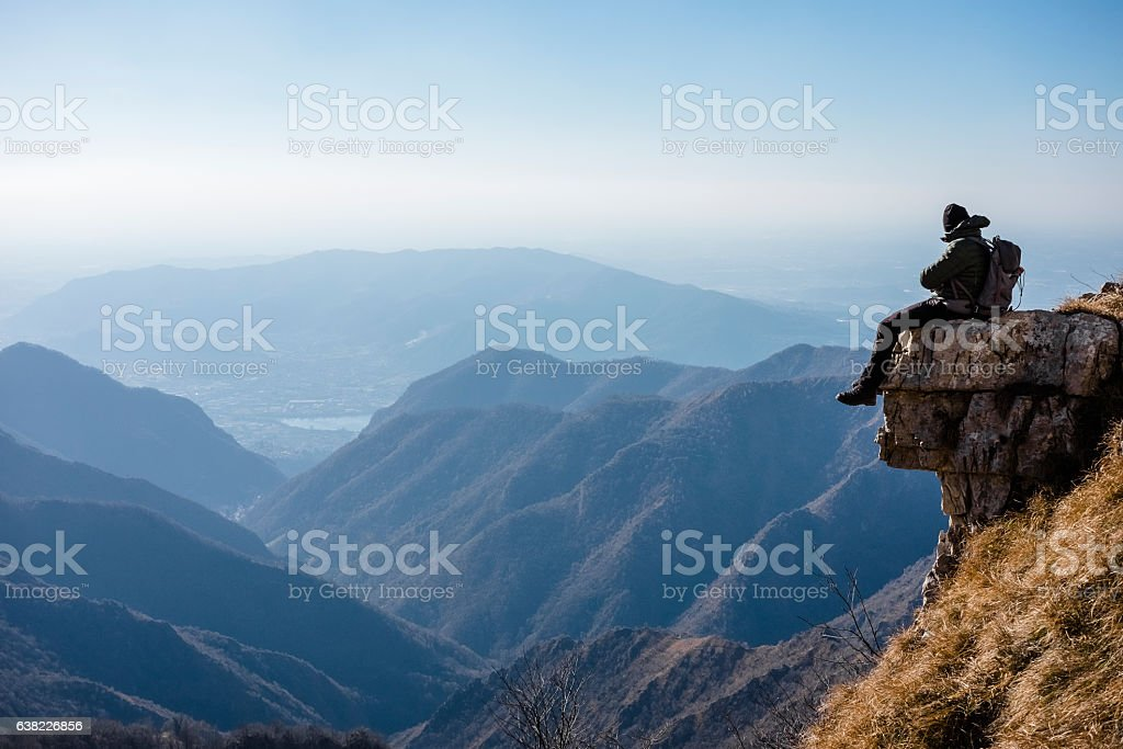 Hiker climber resting on top mountain stock photo
