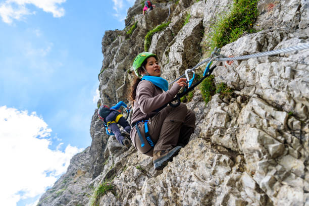 hiker climbing in the mountain of alps, europe - clambering stock photos and pictures