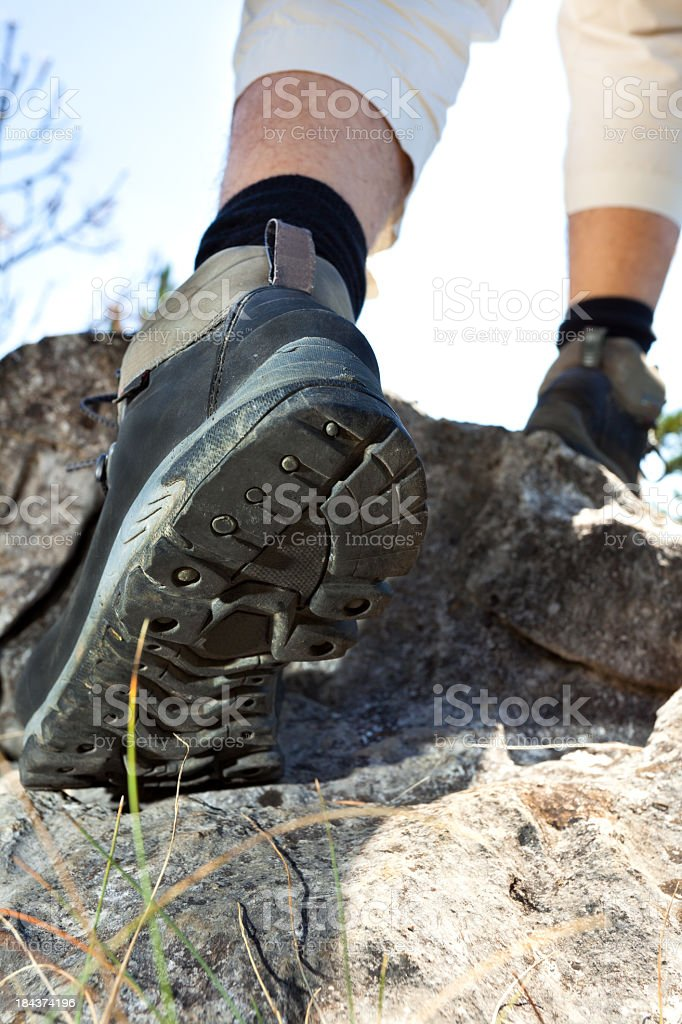 Hiker climbing on mountain royalty-free stock photo