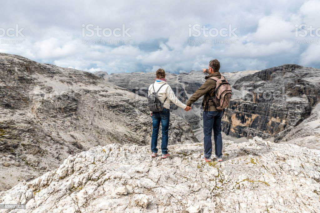 Hiker Couple  in Dolomites of Italy stock photo