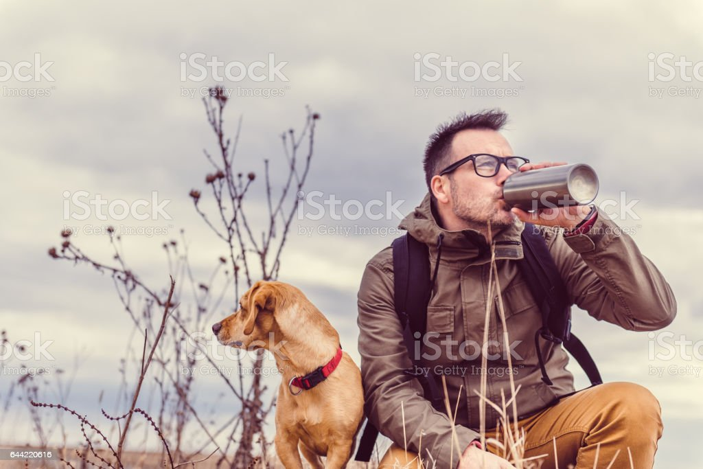 Hiker drinking water stock photo