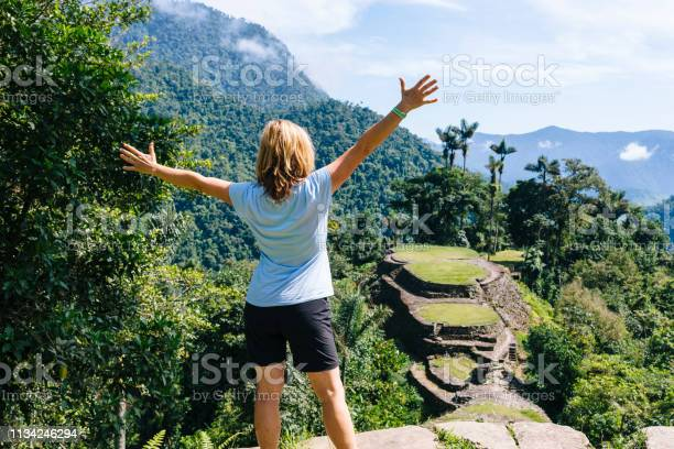 Hiker enjoy the panoramic view on the terraces of the lost city in picture id1134246294?b=1&k=6&m=1134246294&s=612x612&h=ai3t4lsetakkqswxy8bv8xjfcpxfvupiwtxely7o ve=
