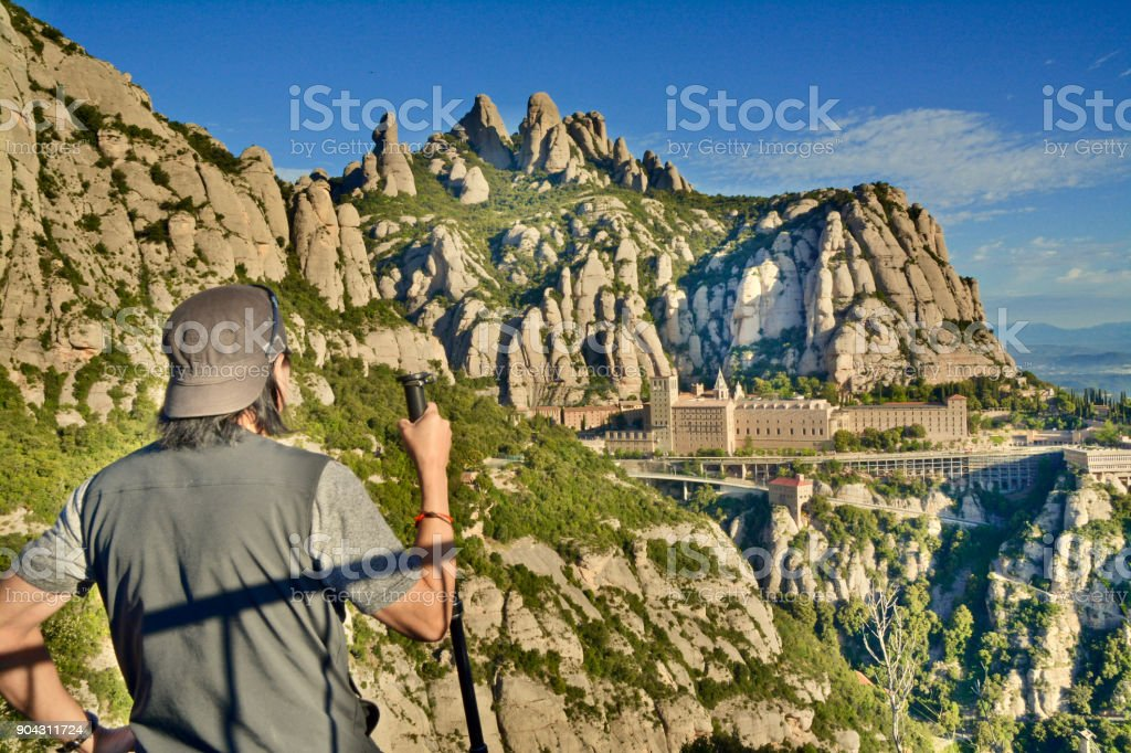 Hiker Enjoys the Mountainview Above the Abbey of Montserrat stock photo