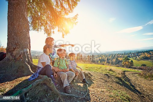 istock Hiker family resting under tree 488875164