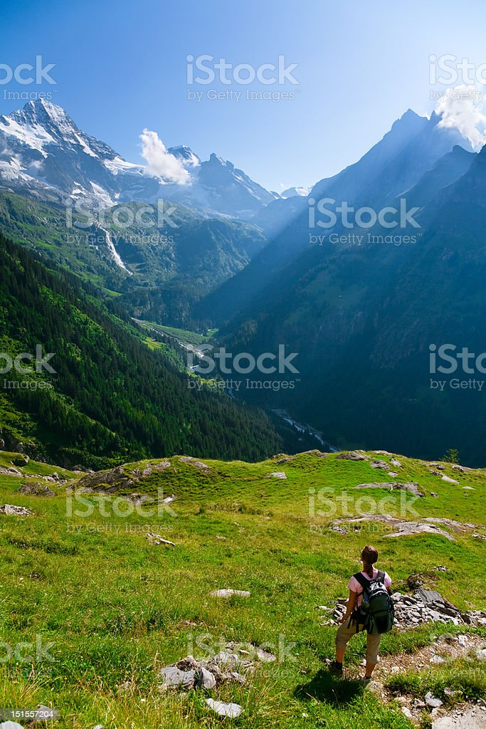 Hiker Gazing at Mountains stock photo