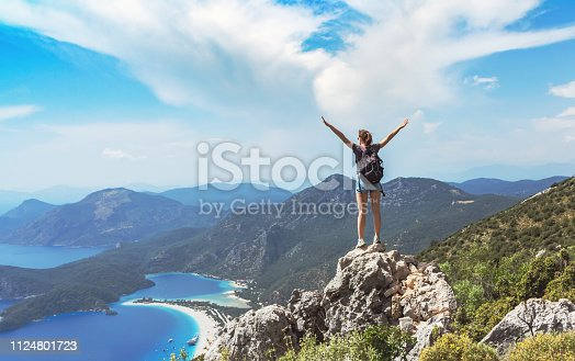 Hiker girl on the mountain top, oncept of freedom, victory, active lifestyle, Oludeniz, Turkey