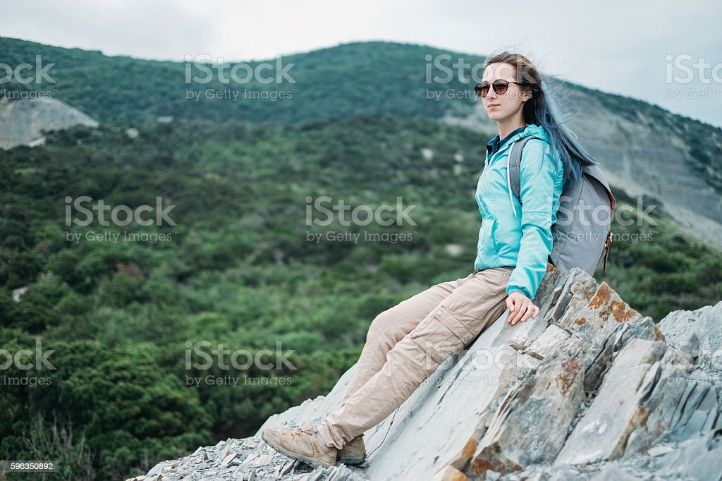Hiker girl resting on rocks royalty-free stock photo