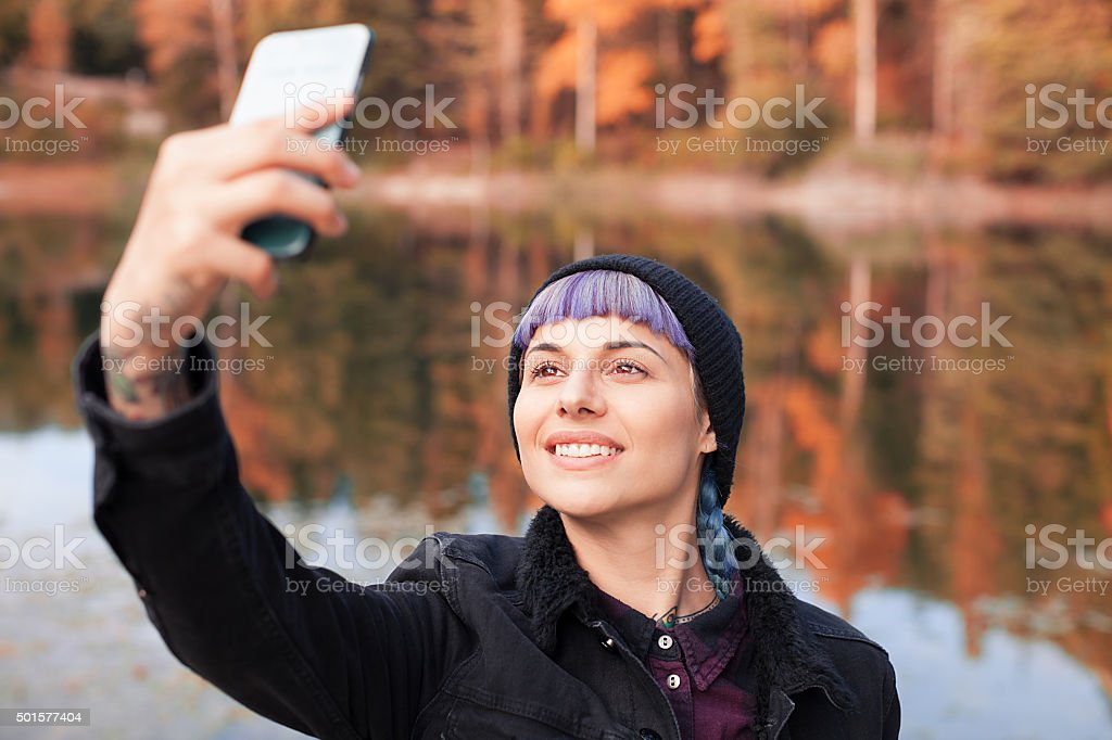 Hiker girl using smartphone at the mountain
