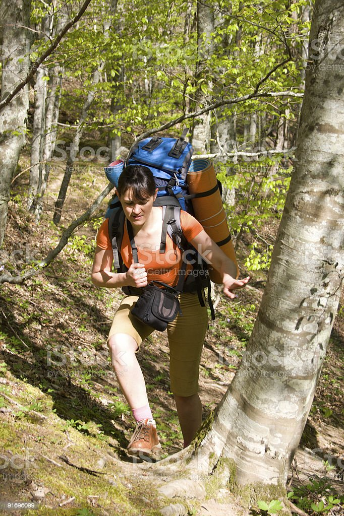 hiker girl with backpack traveling in spring forest royalty-free stock photo