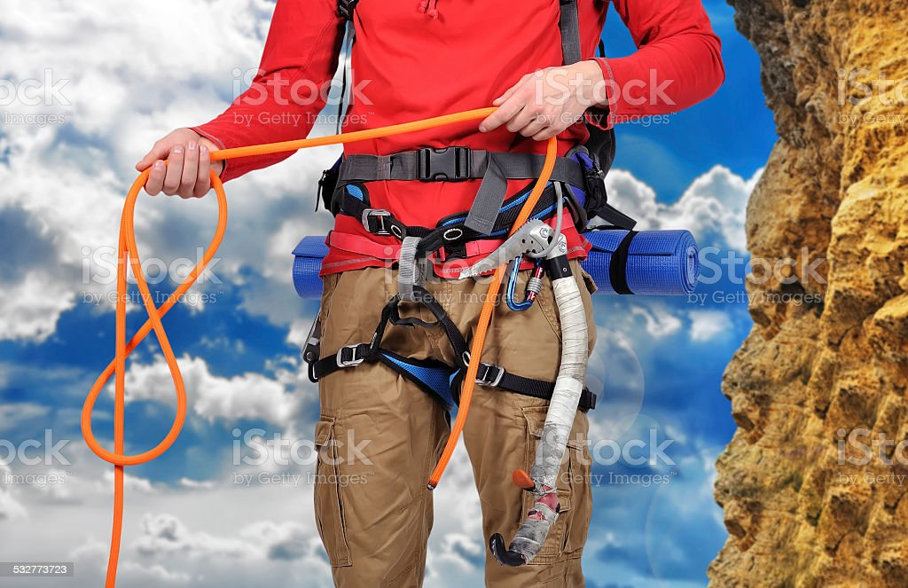 hiker holding rope stock photo