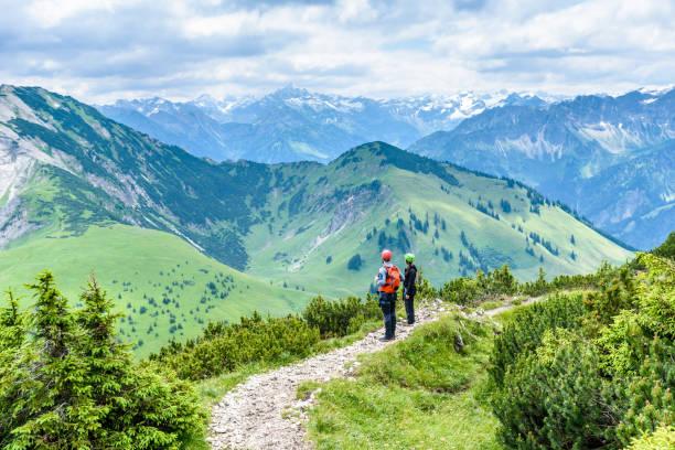 hiker in beautiful landscape of alps in germany - allgäu stock-fotos und bilder