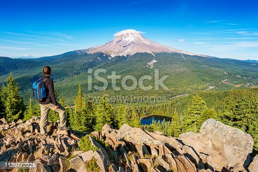 Stock photograph of a hiker looking at view in Mount Hood National Forest Oregon USA on a sunny day.