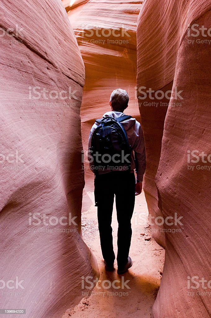 Hiker in slot canyon royalty-free stock photo