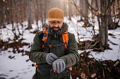 Man in warm clothing on winter hiking tour