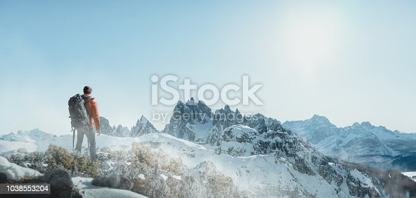 Hiker in snowy mountain landscape