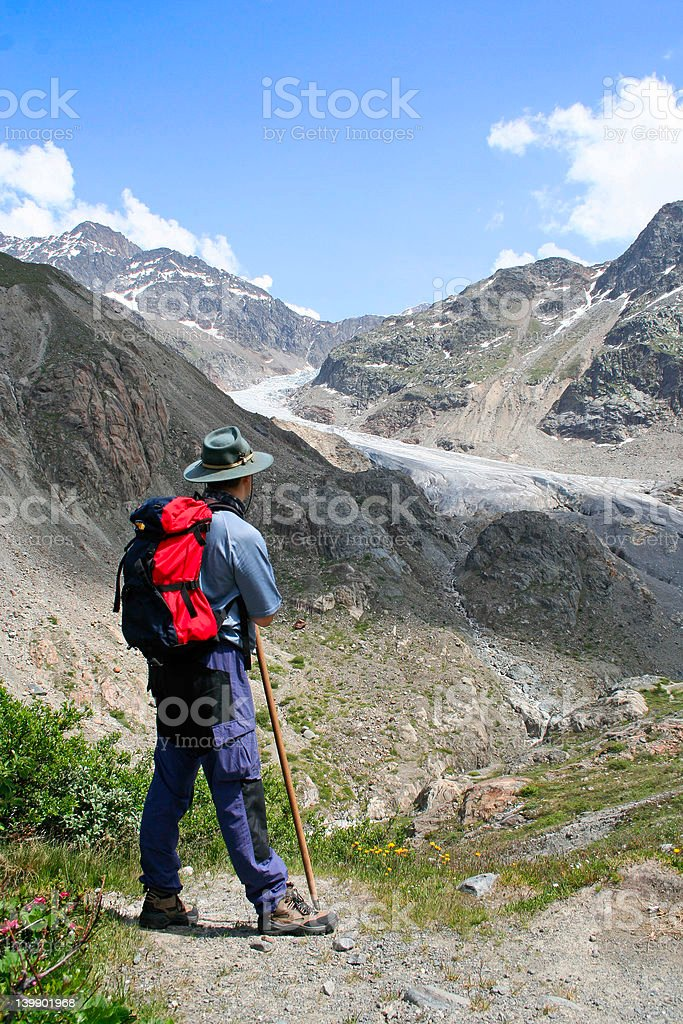 Hiker in the alps royalty-free stock photo