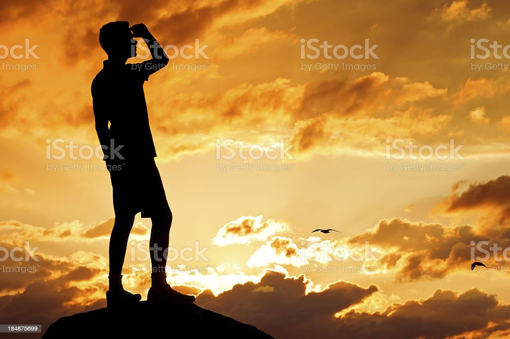Hiker in the dramatic sunset - VII royalty-free stock photo
