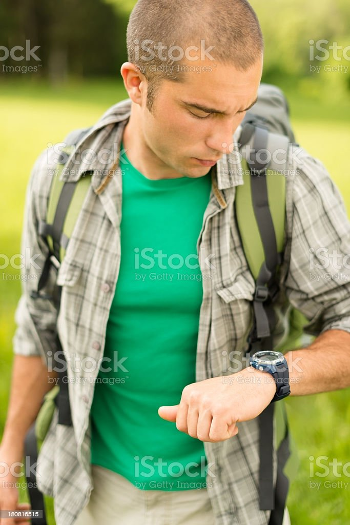 Hiker in The Nature, looking at watch royalty-free stock photo