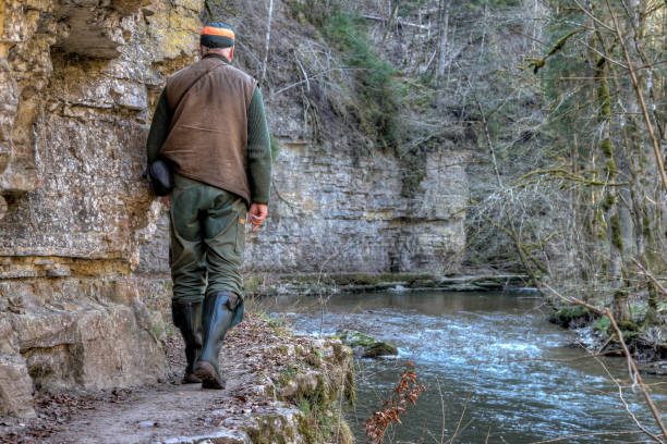 Hiker in the Wutach Gorge on a narrow hiking trail. stock photo