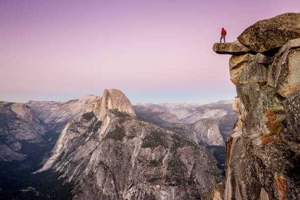 hiker in yosemite national park, california, usa - cliff stock pictures, royalty-free photos & images