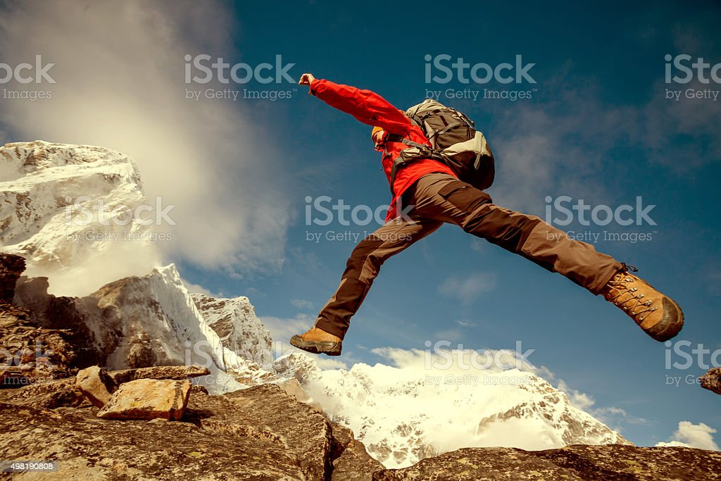 Hiker jumps on the rock near Everest in Nepal stock photo