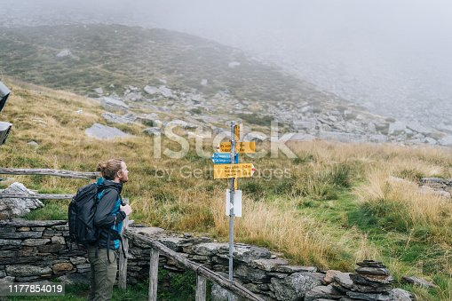 He looks at trail signs for direction