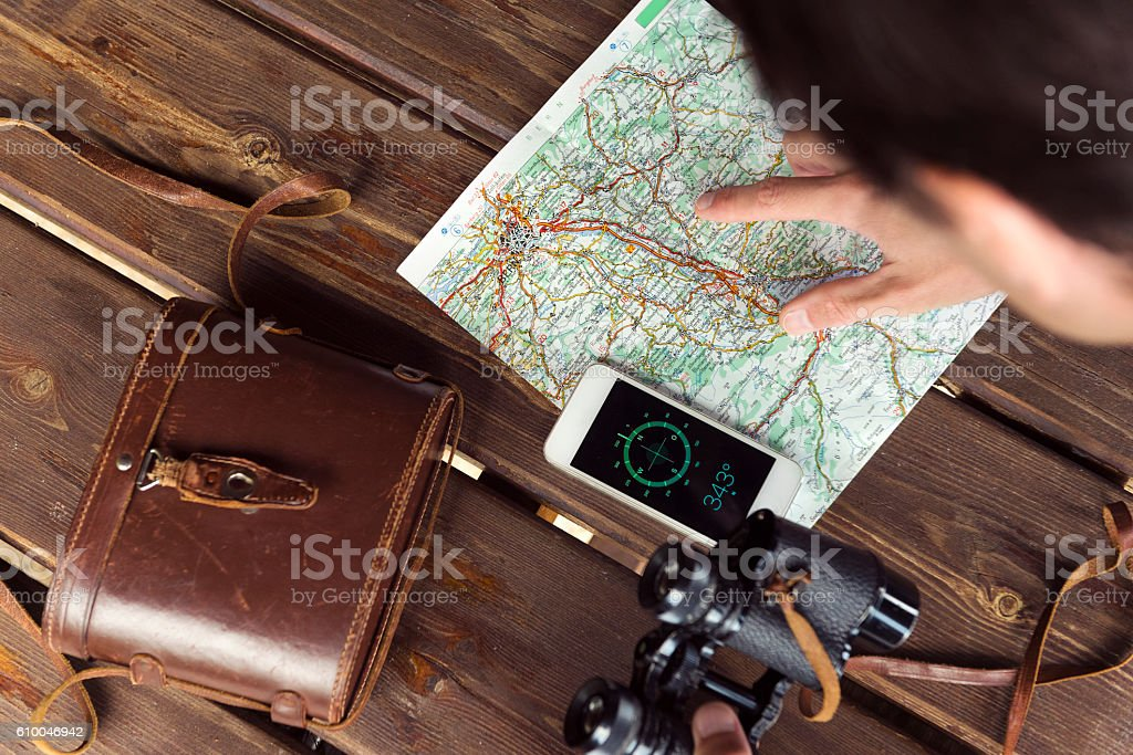Hiker Looking at his Map stock photo
