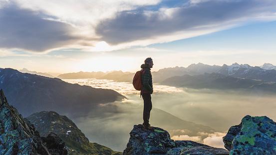 Hiker looking at mountain range