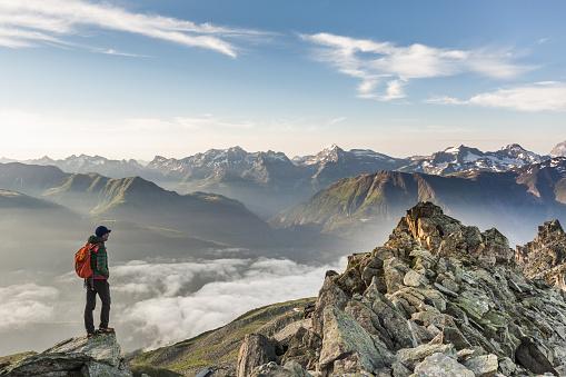 istock Hiker looking at mountain range 847153020