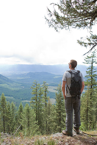 Hiker looking at view from mountain stock photo