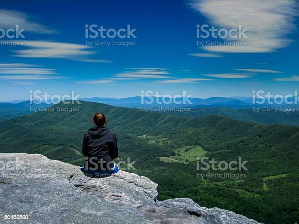 Photo of Hiker Looking Out Over Valley
