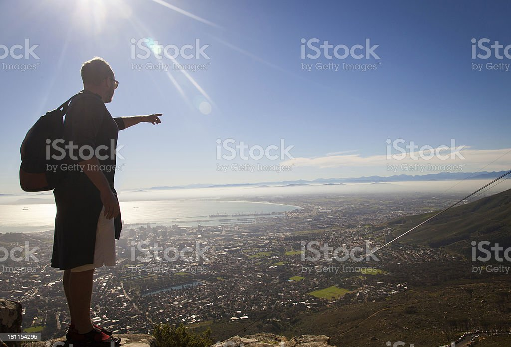 Hiker Looking Over Cape Town City Centre Pointing royalty-free stock photo