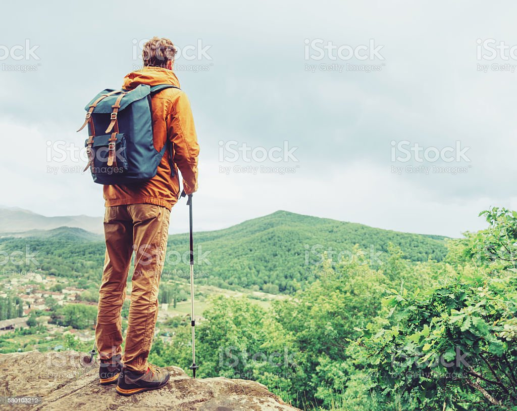 Hiker man in summer stock photo