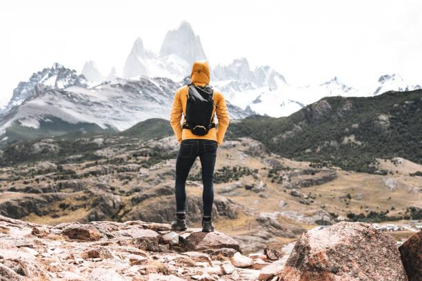 hiker man standing in el chalten stock photo