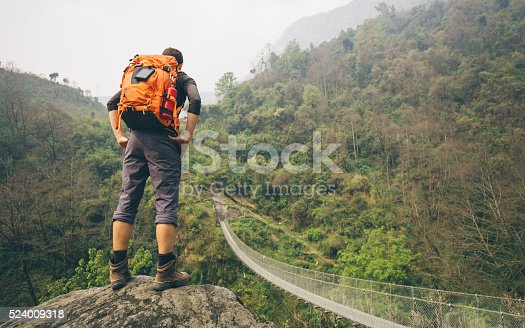 istock Hiker man standing on rock 524009318